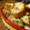 Yummy Garlic Croutons Recipe - You may forget the salad and just eat these fabulous croutons. Olive oil and  garlic powder are sprinkled on before toasting, but the real secret is the dried basil.