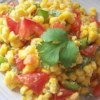 Cilantro Tomato Corn Salad Recipe - Very quick and tasty sidedish that can be altered to taste, almost every ingredient except the corn is optional. Very pretty side dish also.  I've made this for many different people and haven't had one complaint yet. It's especially good if you just don't have the time to cook but don't want junk food.