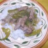 Pepper Steak and Rice Recipe - Steak strips are cooked with onion, garlic, and green peppers, and seasoned with paprika.