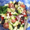 Good for You Greek Salad Recipe - A light salad with a big taste. Olives, tomatoes, red onion, and cucumbers are dressed with olive oil and a splash of lemon juice and finished with crumbled feta cheese.