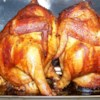 Beer Butt Chicken Recipe - This is a bit unorthodox, but the end result is moist, flavorful and amazing. All you'll need is some chicken, butter, beer, and seasonings.