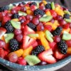 Perfect Summer Fruit Salad Recipe and Video - Layers of fresh fruit are soaked a citrusy sauce in this colorful salad.