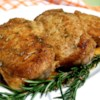 Modenese Pork Chops Recipe - Everyone who has this loves it!  It's surprisingly simple and quick.  Garlic, rosemary, and white wine flavor the pork.  The aroma is wonderful.  Try steaming fresh broccoli, then frying it in the pan juices for a perfect side dish.