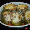 Stuffed Green Peppers II Recipe - Green bell peppers stuffed with ground beef, onion and rice, and then baked and topped with spaghetti sauce.