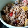 Moroccan Couscous Recipe - An array of toasted spices, vegetables, and fruits complement this beautiful couscous. This dish is great served with the Lamb Tagine and Cucumber Raita, also on this site.
