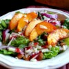 Peach Salad with Raspberry Vinaigrette Recipe - This peach salad recipe includes spinach, almonds, and Asiago cheese tossed in a raspberry vinaigrette for a colorful and refreshing starter or side salad for a summer meal.