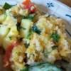 Zucchini Herb Casserole Recipe - Celebrate summer with this quick casserole made with zucchini, herbs, cheese, and rice.