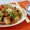 Tofu and Veggies in Peanut Sauce Recipe - This is a quick and easy way to make a well balanced, delicious meal.  Broccoli, red bell pepper and mushrooms are sauteed with tofu in a savory peanut sauce.  Serve over your favorite rice.