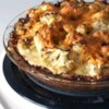 Cauliflower Cheese Pie Recipe - The crust for this delicious pie is made from grated potatoes. Lots of Cheddar cheese goes in next and then a lovely sauteed mixture of grated cauliflower, onion, garlic, thyme and a generous sprinkling of paprika. Bake until firm and crusty brown.