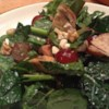 Kale, Swiss Chard, Chicken, and Feta Salad Recipe and Video - Raisins, toasted walnuts, and an apple cider vinaigrette add the finishing touches to this toothsome salad.