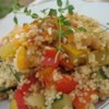 25-Minute Tunisian Vegetable Couscous Recipe - A quick, versatile way to prepare couscous with summer vegetables -- zucchini, yellow squash, and bell peppers, with mushrooms and chickpeas. This fragrant dish is seasoned with smoky paprika, cardamom, and orange zest.