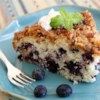 Blueberry Coffee Cake III Recipe - A simple coffee cake studded with blueberries and topped with a crunchy pecan streusel.
