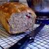 Cranberry Walnut Bread Recipe - Your bread machine makes this marvelous buttermilk bread laced with a whisper of cinnamon, and accented with fruit and nuts.  Try it toasted or plain.