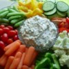 Baked Potato Dip Recipe - All the ingredients you love on a steaming baked potato -gathered up into one rich dip. Serve it with chips for a refreshing change from the requisite crock of onion mix.