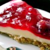 The Best Unbaked Cherry Cheesecake Ever Recipe and Video - This light and delicious no-bake cheesecake is made with cream, cream cheese, and cherry pie filling.  Light and fluffy unbaked cheesecake. Very fast and easy to make. Husband refuses to eat baked cheesecake after eating this!