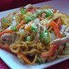 Sweet and Spicy Pork and Napa Cabbage Stir-Fry with Spicy Noodles Recipe - Chili sauce lends both sweetness and spiciness to this noodle dish featuring napa cabbage, celery, carrots, and pork.