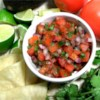 Pico de Gallo Recipe - This fresh tomato salsa is made with red onion, minced jalapeno, lime juice, and seasonings. For best flavor, let it chill for 3 hours before serving.