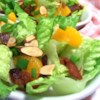 Almond Mandarin Salad Recipe - Sweet mandarin oranges, crunchy almonds, fresh green onion, and crispy bacon are all tossed together with red leaf lettuce and a light honey mustard vinaigrette. Oh, so good and refreshing. Enjoy!