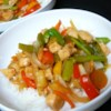 Sweet and Sour Chicken III Recipe - Carrots and red and green bell peppers add lots of color to this classic sweet pineapple and sour soy-vinegar chicken stir fry with just a whiff of ginger.