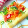Garden Veggie Pizza Squares Recipe and Video - Pre-packaged crescent roll dough gets baked into a single rectangle, then topped with ranch dressing-spiked cream cheese and crunchy vegetables.