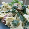 Sausage and Bow-Tie Pasta Florentine Recipe - Bowtie pasta, spicy Italian sausage, frozen spinach, and prepared Alfredo sauce make for a quick and hearty meal.