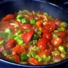 Okra and Tomatoes Recipe - Okra is sauteed in bacon grease with onion, green pepper, celery, and stewed tomatoes in this simple side dish.