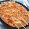 Grilled Tequila-Lime Shrimp Recipe - Shrimp seasoned with a zesty lime-tequila marinade flavored with garlic, cumin, and ground black pepper are grilled on skewers for a tasty appetizer.