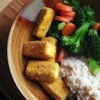 Breaded, Fried, Softly Spiced Tofu Recipe - This tofu recipe is completely gorgeous. Tofu is soaked in vegetable broth, then breaded with flour, sage, and cayenne, and deep fried. Serve with a relish or a dip of some sort (I love this with plain yogurt mixed with eggplant brinjal).