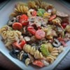 Greek Pasta Salad I Recipe and Video - Taste the earthy flavors of the Mediterranean in every bite of this colorful summer salad. Tangy feta cheese, fresh mushrooms, tomatoes, onions, bell peppers and olives are tossed with spicy pepperoni and macaroni in an herb-infused vinaigrette.