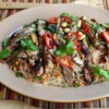 Spicy Rice Noodle Salad Recipe and Video - Grilled chicken thighs top this main dish salad that showcases the spicy and sweet flavors of Thai food. Toss with fresh herbs, vegetables, and crunchy peanuts for a simple and light-tasting meal.
