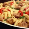 Bow Tie Pasta with Sausage and Sweet Peppers Recipe - Bow tie pasta in a sausage, bell pepper broth.