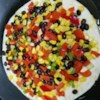 Santa Fe Veggie Quesadillas Recipe - I've made this quick and colorful appetizer for many great dinner parties. Serve with fresh salsa, guacamole or sour cream as dipping sauces--or by itself.
