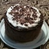 Perfect Chocolate Cake Recipe - An incredibly moist, rich, triple layer chocolate cake with whipped cream filling and chocolate buttercream frosting.  This was always a favorite in our house!