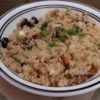 Quinoa Salad with Dried Fruit and Nuts Recipe - This is an unusual and tasty high-protein grain salad. Quinoa is a grain that has almost no flavor, but the spices add zest. It's well worth trying, I make it often since discovering quinoa at my health food store.