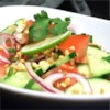 Thai Cucumber Tomato  Salad Recipe - Give that summer salad a twist of Thai flavor with cucumbers, tomatoes, lime juice, cilantro, and chopped peanuts.
