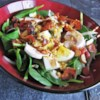 Spinach Salad with Warm Bacon-Mustard Dressing Recipe - This is a classic steakhouse-style spinach salad with the absolute best warm bacon-mustard dressing I've ever had! Looks and tastes like a lot of work, but can be prepared in no time! This salad can easily be converted to a main dish salad by adding strips of grilled chicken breast.