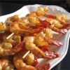 Honey Grilled Shrimp Recipe - Easy and delicious! Onions, peppers, and mushrooms are perfect when alternated with shrimp on the skewers. Just cut into bite-sized pieces and add them to the marinade with the shrimp. Serve with rice and a salad.