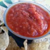 Roasted Tomato Salsa I Recipe - This chunky, smoky salsa tastes amazing with tortilla chips. Roasted tomatoes, garlic, onion and jalapeno are blended with cilantro and cumin to create one of the tastiest and easiest Mexican-inspired recipes you'll ever try.