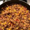 Ground Beef Curly Noodle Recipe - An easy, quick and economical recipe that kids really like. Ground beef, noodles, corn and tomatoes make a complete meal in one skillet. My sister who ran a daycare used to make this and everybody enjoyed it.