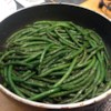 Pan Fried Green Beans Recipe - Garlic powder, onion powder, salt and pepper are caramelized with fresh green beans, lending a grilled flavor to the tender-crisp beans.
