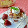 Rhubarb Strawberry Crunch Recipe and Video - Slices of strawberry and rhubarb are topped with a buttery, brown sugar and oat crumble then baked until golden brown and crunchy.