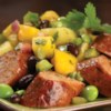 Spicy Jalapeno Chicken Sausage with Mango, Pineapple Salsa Recipe - Spicy Jalapeno Chicken Sausage, mango, and pineapple salsa is served over cilantro rice for this island-inspired dinner.