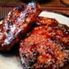 World's Best Honey Garlic Pork Chops Recipe - A quick and simple grilled pork chop that everyone will love featuring a simple and easy glaze of ketchup, honey, soy sauce, and garlic.