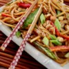 Peanut Noodles Recipe and Video - Ginger comes alive when its warmed, and it gets that opportunity in this tasty sauce. All the ingredients  - peanut butter to sesame oil -are warmed together in a pan until their flavors blend and the sauce becomes flavorful.