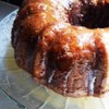 Apple Honey Bundt Cake Recipe - This moist and delicious cake is filled with grated apple and chopped nuts. Drizzle with additional honey or dust with powdered sugar before serving.