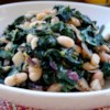 Greens with Cannellini Beans and Pancetta Recipe - This is a forgiving recipe, and a great way to get your greens! Kale is cooked with onions and garlic, a small amount of pancetta or bacon, and cannellini beans to make a great main dish for two or side dish for 4 or more.