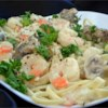 Shrimp Fettuccine Alfredo Recipe and Video - Rich and creamy Alfredo sauce with Parmesan cheese, garlic and plenty of shrimp.