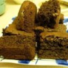 Bodacious Brownies Recipe - My kids love them, they all ways want me to make them. I drizzle them with melted chocolate and vanilla-flavored candy coating. Delicious!