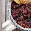 Cranberry Salsa Recipe and Video - Made in minutes in a food processor, this sweet-tangy cranberry salsa gets its heat from a jalapeno pepper combined with chopped cilantro, green onions, lime juice, and sugar.