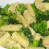 Broccoli with Rigatoni Recipe - Broccoli florets are sauteed with garlic, butter and olive oil, simmered in broth, then tossed with fresh basil and hot rigatoni. A sprinkle of Parmesan cheese is the perfect finish. Hint: don't overcook the garlic and broccoli!